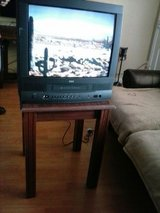 Tv with the and end table in Lackland AFB, Texas