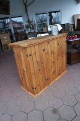 nice solid wood bar with bottle holders and shelves in the back in Ramstein, Germany