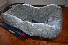 Infant car seat with a cover in Dothan, Alabama