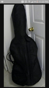 Cello with case and bow in Lake Charles, Louisiana