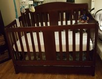 Crib with mattress, drawer, and toddler conversion rail in Fairfax, Virginia