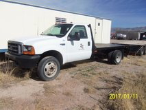 1999 Ford F550 7.3 Powerstroke 11 ft. Steel Flat Bed & Gooseneck Hitch in Alamogordo, New Mexico