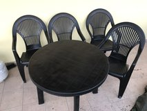 Plastic patio table and chairs in Ramstein, Germany