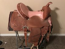 Pink ostrich seat saddle with breast collar in Houston, Texas