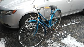 Throwback antique women bicycle in good riding condition with hands brakes and tires protectors in Glendale Heights, Illinois