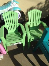 2 kids outside chairs in Oceanside, California