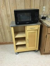 Microwave and stand in Joliet, Illinois