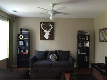 Grey couch, love seat & 2 black side tables with a center coffee table in San Clemente, California