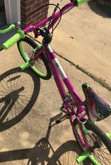 Girls green, pink and purple bicycle in Fort Benning, Georgia