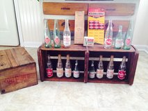 Old crates, bottles, and general store merchandise in bookoo, US