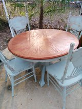 Distressed dining room table with 4 chairs in Fort Benning, Georgia