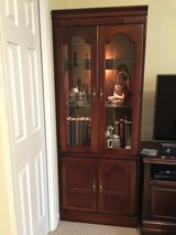 pair of cherry, lighted bookcases in Fort Campbell, Kentucky