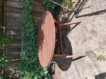 Redwood round picnic table in Colorado Springs, Colorado