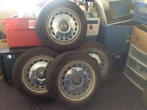 4 Cadillac rims and tires five lug P235 70 R15 in 29 Palms, California