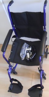Easy Travel Wheelchair with leg attachments in Lockport, Illinois