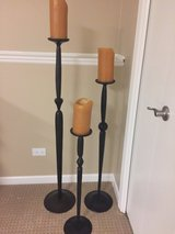 Set of three bronze floor candle holders from Pottery Barn in Naperville, Illinois
