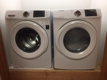 Samsung 4.2 -cu ft High efficiency stackable front load washer & 7.5 CU FT dryer (white) in Batavia, Illinois