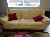 Yellow leather couch and love seat in Camp Pendleton, California