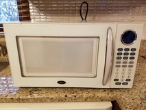 Oster 1000 W Microwave with revolving glass plate - used one time! in Chicago, Illinois