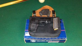 Smith and Wesson 380 bodyguard with laser built in. Half box of bullets. Concealed holster. in Fort Rucker, Alabama