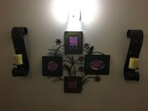Picture wall decor and candle sconces in Vista, California