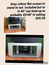 Silver/Grey flat screen tv stand in Joliet, Illinois