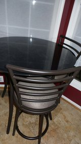 Black metal frame round glass top table with  4 chairs. in Bolling AFB, DC