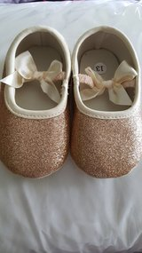 Gold glitter bow infant shoe in Joliet, Illinois