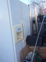 White side-by-side refrigerator works great needs cleaned in 29 Palms, California