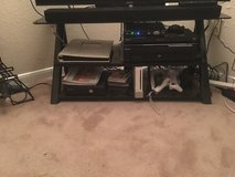 40 inch Sony TV with added sound bar and glass stand in Baytown, Texas