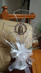 Silver beaded decorative cross in Lockport, Illinois