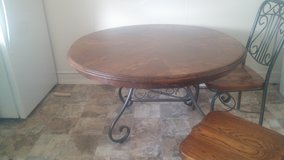 "Solid oak table w/ matching chairs and 20"" leaf in Fort Carson, Colorado"