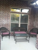 Wicker patio set with cushions and glass table in Eglin AFB, Florida