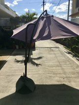 8' Patio Umbrella that swivels in wind and has projector arm with pedestal in Okinawa, Japan