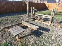 Cedar bench and table, wooden rack, and firewood in Fort Campbell, Kentucky