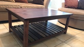 Brown wooden coffee and end table set in Eglin AFB, Florida