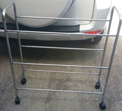 Metal rack for holding tubs in Houston, Texas