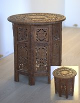 Folding carved wooden end table in Ansbach, Germany