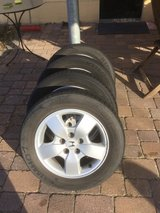 1 set of Honda tires and rims good tread came off a CRV ,All weather. 205/60R16 in Ramstein, Germany