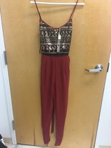 Red and black jumpsuit in Wilmington, North Carolina