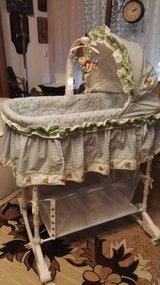 Rocking Baby bassinet w/cargo net,mobile,mattress.new cond. in Ramstein, Germany