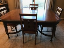1940-1950's walnut dinning room table w/ 6 chairs in Fort Carson, Colorado