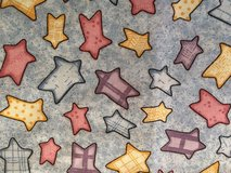 Beautiful fabric different size stars on soft blue background. in Yucca Valley, California