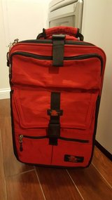 Kiva sports red suitcase with wheels in St. Charles, Illinois