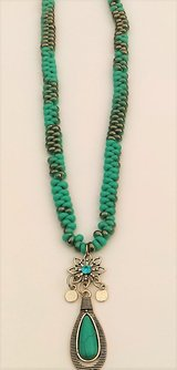 "Turquoise flower teardrop pendant necklace. 21"" long, pendant 1 1/2 "" long in Wilmington, North Carolina"