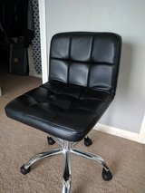 Black leather computer desk chair in Yucca Valley, California