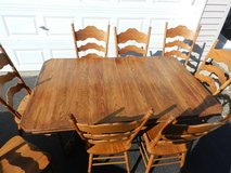 Solid oak table with 8 chairs and 4 leaves in Sandwich, Illinois