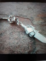 Wrapped Crystal pendulum belly ring in Camp Lejeune, North Carolina
