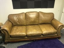 leather couch / real wood detail in Fort Carson, Colorado