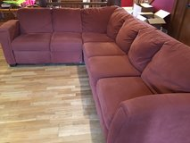 L shaped red couch in Conroe, Texas